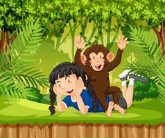 Uma menina e um macaco na selva