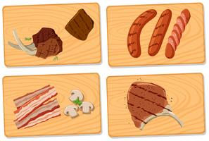 Variedade de carne em tábuas de cortar vetor