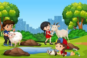 Grupo de crianças e animais no parque vetor