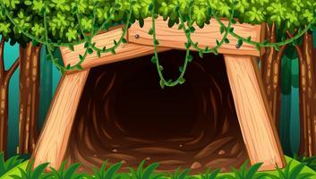 Uma caverna de mina vista de fora vetor