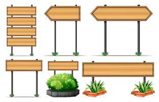Sinais de madeira e arbusto vetor