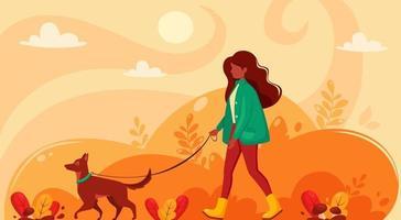 mulher negra andando com o cachorro no outono. parque de outono. vetor