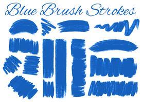 Conjunto de pinceladas azuis vetor