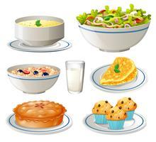 Tipo diferente de comida em placas vetor