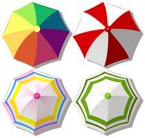 Guarda-chuvas coloridos em branco vetor