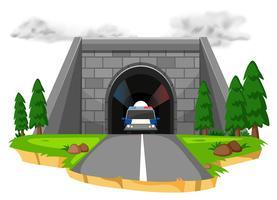 Carro de polícia no túnel vetor