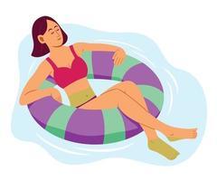 mulher é desfrutar flutuando no ringue inflável na piscina no verão. vetor
