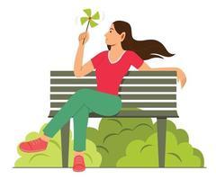 mulher apreciar o moinho de papel enquanto está sentado no banco no jardim. vetor
