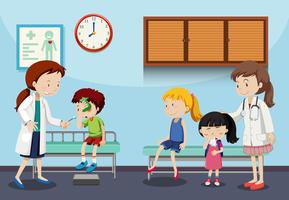 Crianças e médicos na clínica