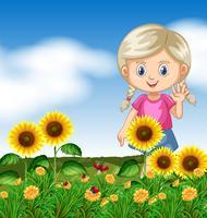 Linda garota no jardim de girassol