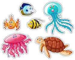 Adesivo conjunto de animais marinhos vetor
