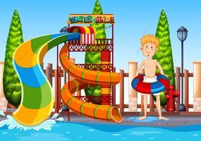 Um homem no parque aquático vetor