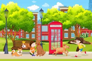 Crianças e cachorro no parque vetor