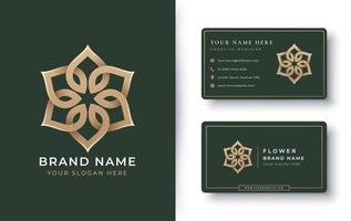 logotipo da mandala de flor dourada com cartão de visita vetor