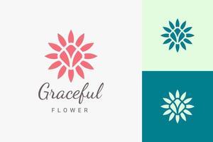 logotipo de spa de beleza ou ioga em logotipo de flor plana e abstrata vetor