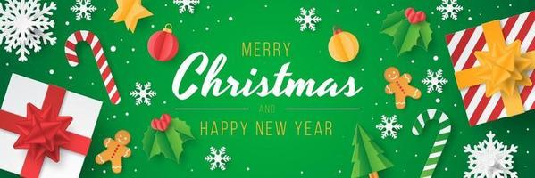 banner de Natal com elemento de Natal cortado em papel. vetor