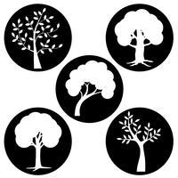 silhuetas de árvore branca em círculos pretos vetor