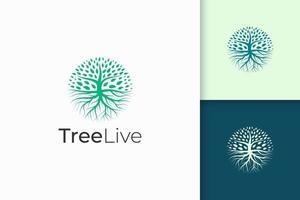 logotipo da árvore do círculo com raiz na cor verde e forma moderna vetor