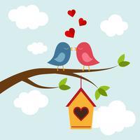 Dois pássaros apaixonados na árvore vetor