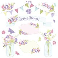Flores da primavera em frascos de pedreiro