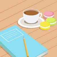 Café e três diferentes macaroons coloridos na mesa