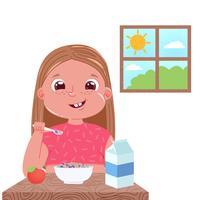 Uma menina come café da manhã