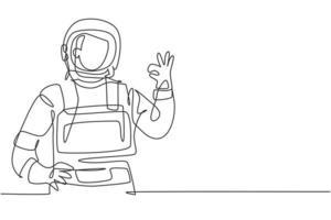 único desenho de uma linha de astronautas masculinos com gestos ok vestindo trajes espaciais para explorar o espaço sideral em busca dos mistérios do universo. linha contínua moderna desenhar design gráfico ilustração vetorial vetor
