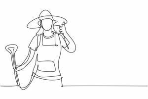 contínua uma linha desenhando uma agricultora com um gesto de polegar para cima, usando um chapéu de palha e carregando uma pá para trabalhar na fazenda na época da colheita. ilustração gráfica do vetor do desenho do desenho de linha única.