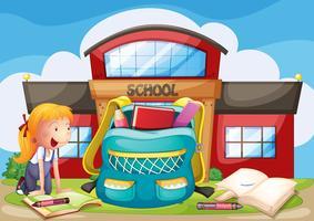 Uma menina com ela material escolar em frente ao prédio da escola vetor