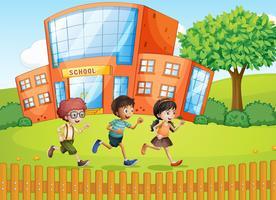 Crianças e uma escola vetor