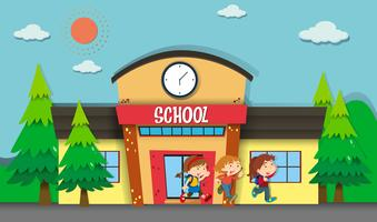 Crianças saindo da escola à noite