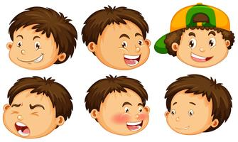 Um menino com expressão facial vetor