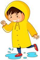 Menino, em, amarela, raincoat vetor
