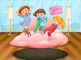 Três meninas brincando na festa do pijama