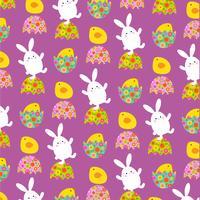 Coelhinho da Páscoa e pintos padrão em roxo vetor