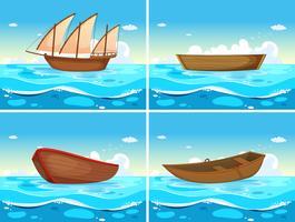 Quatro cenas de barcos no oceano vetor