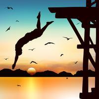 Silhueta e homem de salto no crepúsculo com céu azul.