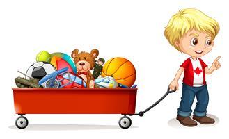 Menino puxando carrinho cheio de brinquedos