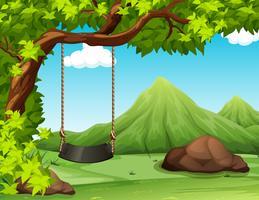 Cena da natureza com balanço na árvore vetor