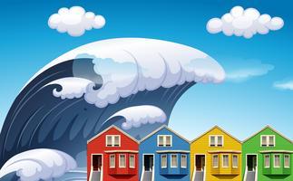 Tsunami com ondas grandes sobre casas