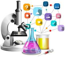 Microscópio e copos de vidro