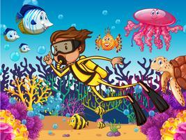 Mergulhador mergulhando debaixo d'água com muitos animais marinhos vetor