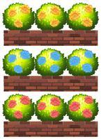 Flores nas paredes de tijolo vetor