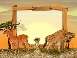 Design de moldura com animais selvagens no campo
