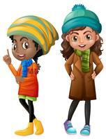 Duas meninas em roupas de inverno vetor