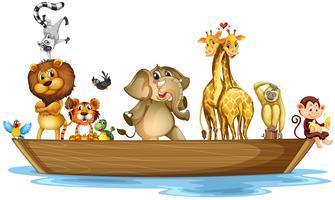 Animais selvagens andando no barco vetor