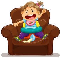 Jovem criança fazendo bagunça no sofá vetor