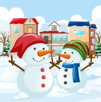 Dois boneco de neve no campo vetor