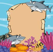Modelo de papel com tubarões no oceano vetor