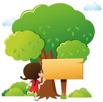 Modelo de sinal de madeira com menina e árvore